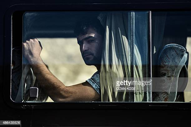 A relative of Aylan Kurdi whose lifeless body washed ashore on a Turkish beach is seen in a bus on his way to Kobane where the boy's funeral will...
