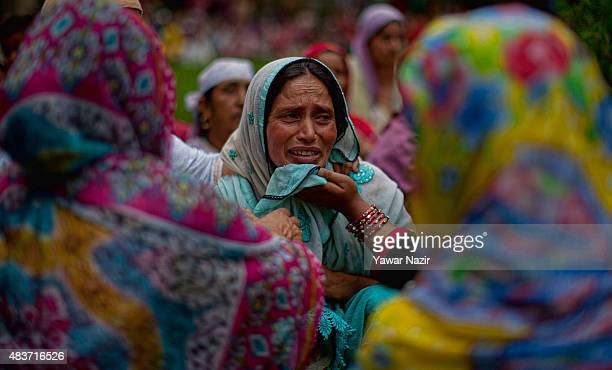 A relative of Bilal Ahmad Bhat a civilian who was allegedly shot dead by Indian paramilitary Border Security Force mourns during his funeral on...