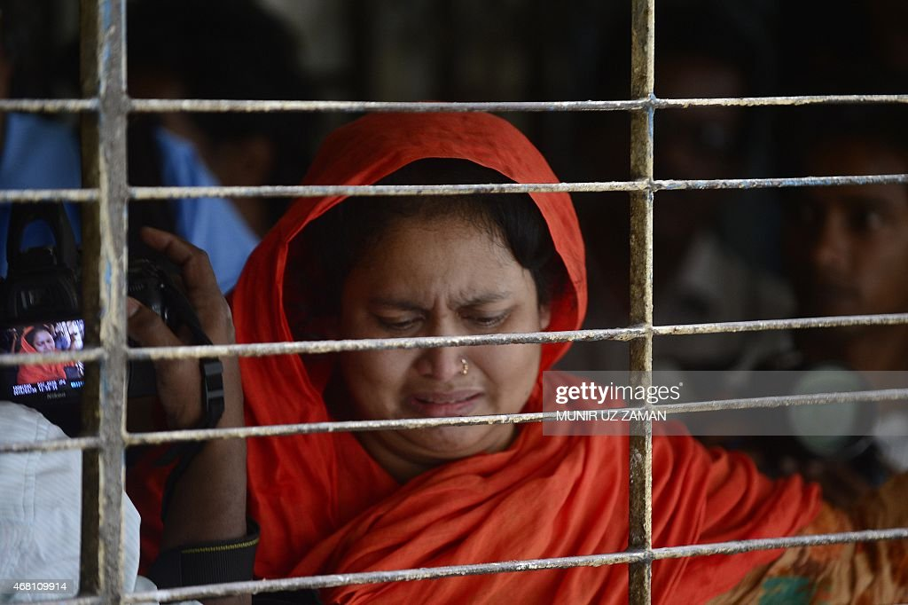 A relative of dead Bangladeshi blogger Washiqur Rahman reacts after seeing his body at Dhaka Medical College in Dhaka on March 30 after he was killed...