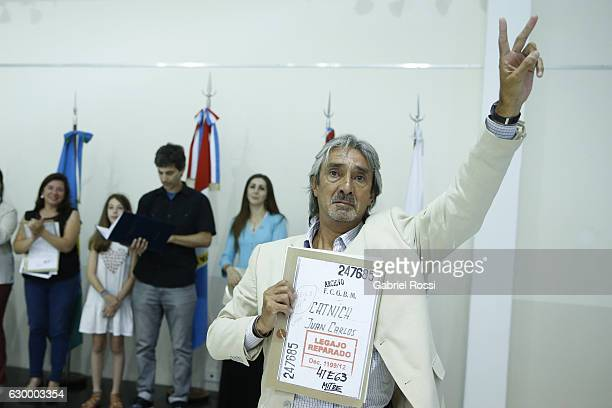 Relative of disappeared railway worker Juan Carlos Catnich gestures during the delivery of repaired files to the descendants of 20 disappeared...