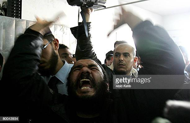 A relative of fivemonth old Mohammad Naser AlBuri shouts during his funeral February 28 2008 in Gaza City Gaza AlBuri who is the son of the UNRWA of...