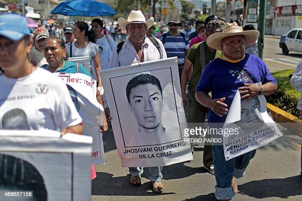 A relative of Mexican missing student Jhosivani Guerrero de la Cruz holds his portrait during a march in Acapulco Guerrero State Mexico on March 4...