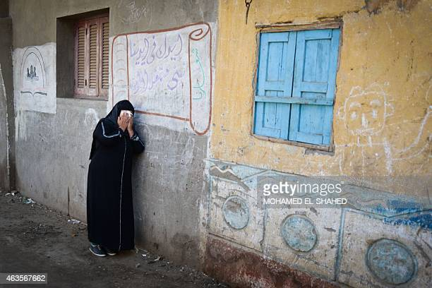 A relative of one of the Egyptian Coptic Christians purportedly murdered by Islamic State group militants in Libya reacts after hearing the news on...