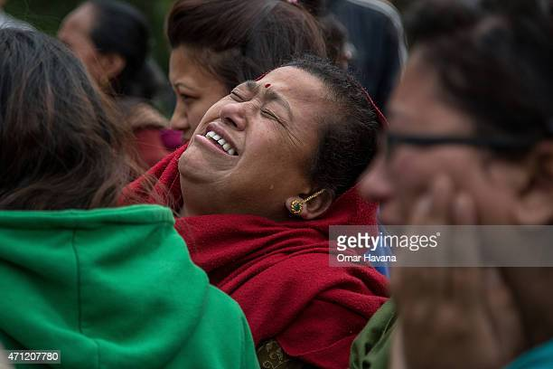 A relative of one of the victims of the earthquake that hit Nepal yesterday cries on April 26 2015 in Bhaktapur Nepal A major 78 earthquake hit...