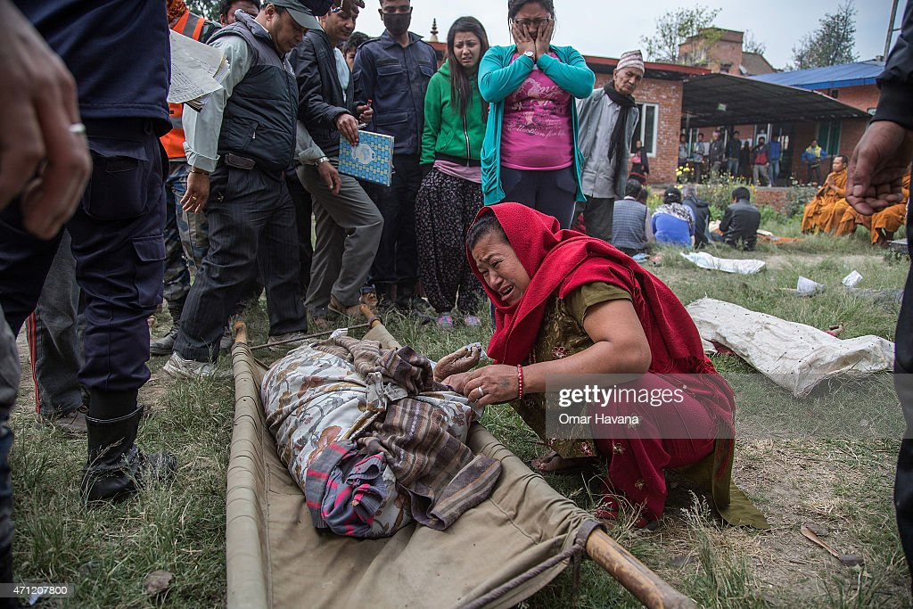 A relative of one of the victims of the earthquake that hit Nepal yesterday cries while identifying the body on April 26 2015 in Bhaktapur Nepal A...