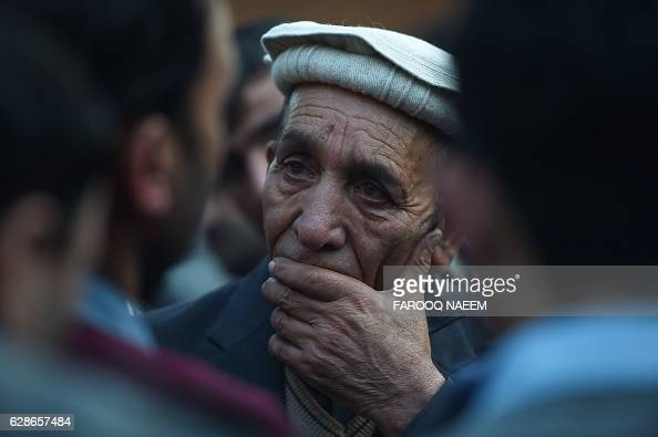 A relative of Pakistani plane crash victims reacts after the absentia funeral prayer at the Pakistan Institute of Medical Sciences hospital in...