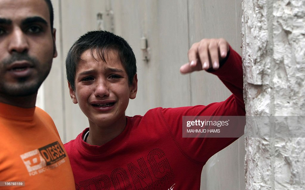A relative of Palestinian boy Abdel Rahman Majdi Naim cries after his cousin was killed in a second Israeli strike on the building housing AFP's offices in Gaza city, according to Hamas health officials, on November 21, 2012. The Israeli military had no immediate comment on the strike, which came less than 24 hours after Israeli warplanes carried out a first raid on the building.