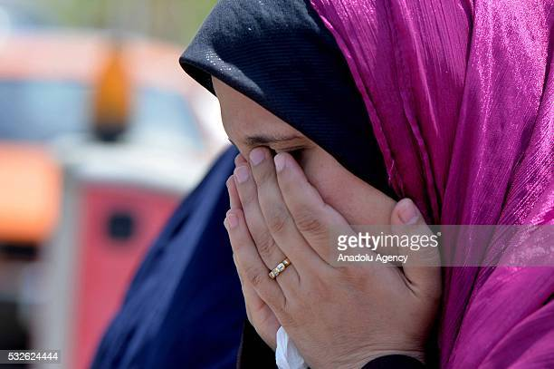 A relative of passenger onboard missing EgyptAir flight MS804 cries at Cairo International Airport as she tries to receive information in Cairo Egypt...