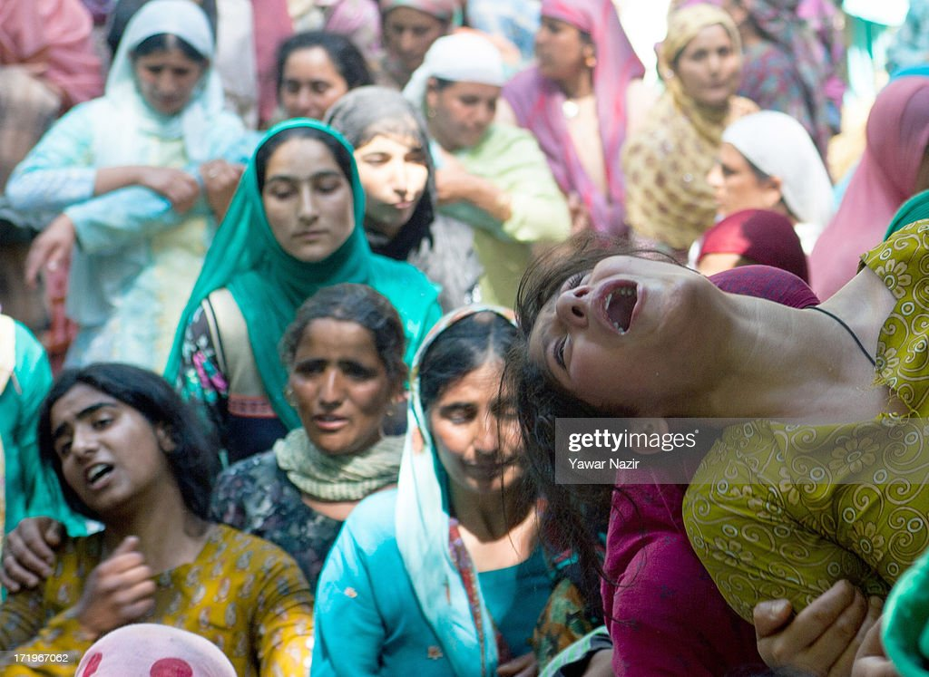 A relative of Tariq Ahmed, a civilian who was killed by Indian army, mourns during his funeral on June 30, 2013 in Kondebal 25 km (15 miles) north of Srinagar the summer capital of Indian administered Kashmir, India. A teenage boy, identified as Irfan Ahmad Ganaie was killed during a search operation by Indian police in the village of Markondal in Bandipora District, before dawn on Sunday. A second person, Tariq Ahmad Leharwal, was killed after the Indian army shot at local residents who were protesting the earlier deadly incident. The killings triggered mass protests in the area.