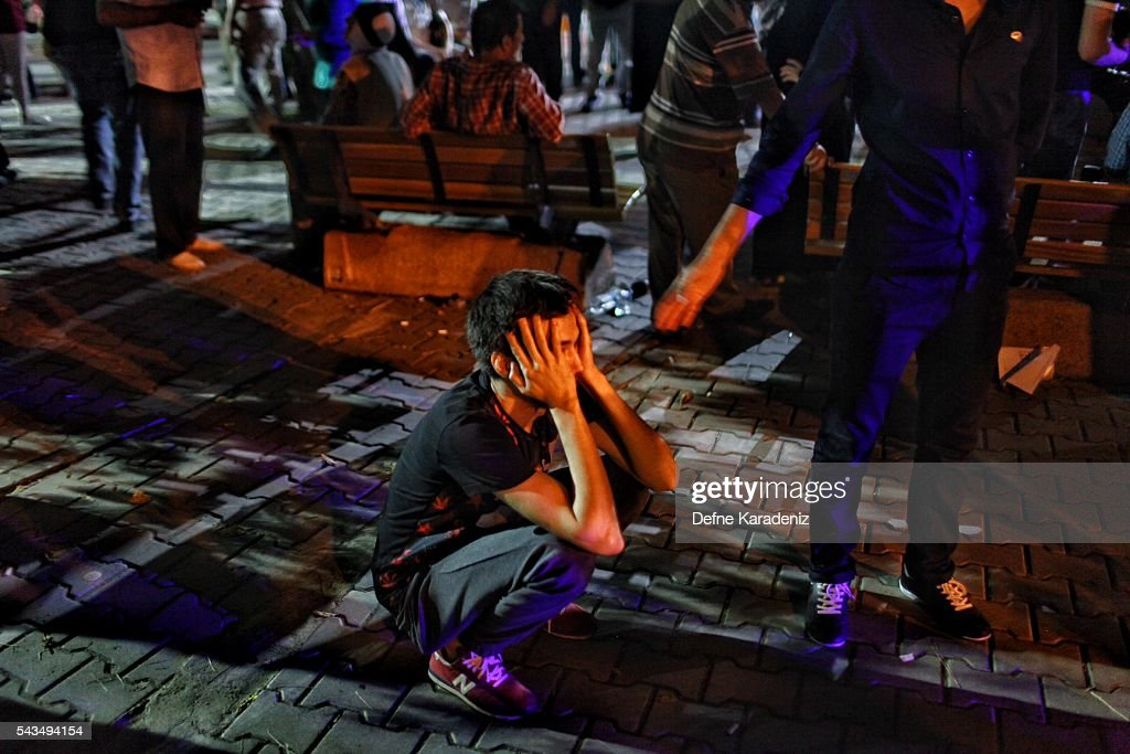 A relative of the Ataturk Airport suicide bomb attack victim wait dejectedly outside Bakirkoy Sadi Konuk Hospital, in the early hours of June 29, 2016 in Istanbul, Turkey. Three suicide bombers opened fire before blowing themselves up at the entrance to the main international airport in Istanbul, killing at least 31 people and wounding 147 people according to Justice Minister Bekir Bozdag.