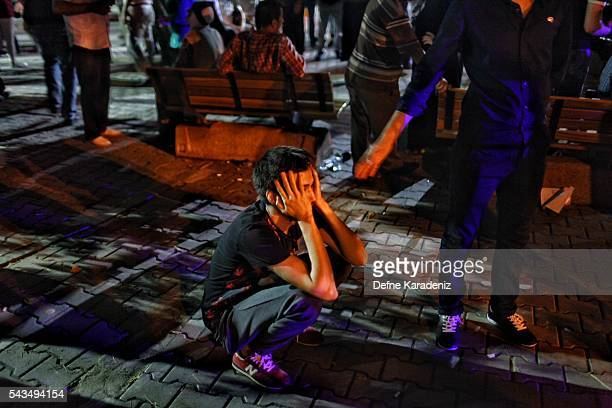 A relative of the Ataturk Airport suicide bomb attack victim wait dejectedly outside Bakirkoy Sadi Konuk Hospital in the early hours of June 29 2016...