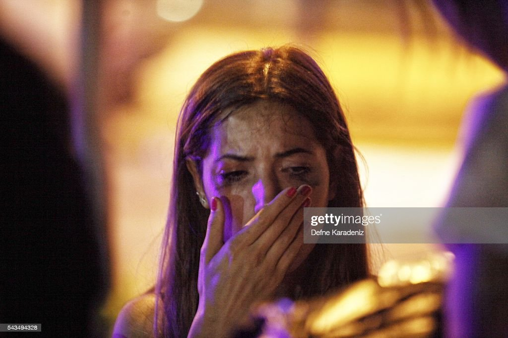 A relative of the Ataturk Airport suicide bomb attack victim waits outside Bakirkoy Sadi Konuk Hospital as she cries, in the early hours of June 29, 2016 in Istanbul, Turkey. Three suicide bombers opened fire before blowing themselves up at the entrance to the main international airport in Istanbul, killing at least 31 people and wounding 147 people according to Justice Minister Bekir Bozdag.