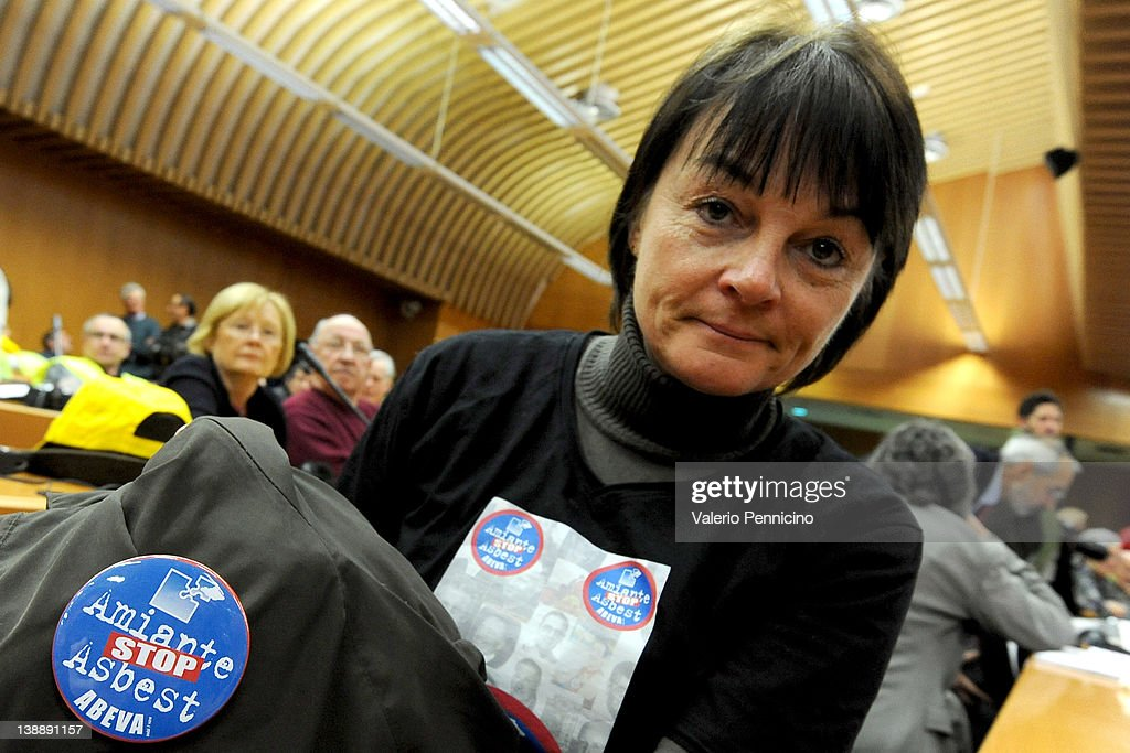 A relative of the victims hold signs saying 'Stop Asbestos' during the Eternit verdict reading on February 13, 2012 in Turin, Italy. The Turin court has convicted Swiss billionaire Stephan Schmindheiny and Belgian baron Jean-Louis de Cartier for 16 years each after they were accused of involuntary manslaughter and disregard for workplace safety regulations, after a three year trial. Around 1500 relatives and friends of the alleged 3000 victims attended the final day of the trial with 160 foreign delegations attending from all over the world.