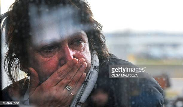 A relative reacts at Pulkovo international airport outside Saint Petersburg after a Russian plane with 224 people on board crashed in a mountainous...