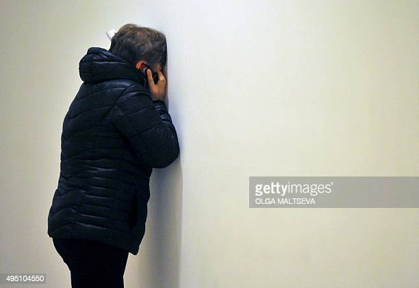 A relative reacts at Pulkovo international airport outside St Petersburg after an Airbus A321 of Russian airline Kogalymavia with 224 people on board...