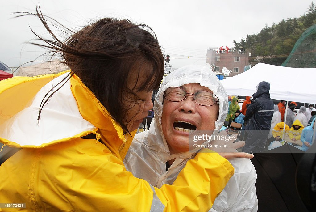 A relative weeps as she waits for missing passengers of a sunken ferry at Jindo port on April 17, 2014 in Jindo-gun, South Korea. At least six people are reported dead, with 290 still missing. The ferry identified as the Sewol was carrying about 470 passengers, including students and teachers, traveling to Jeju Island.
