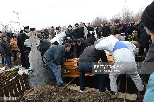 Relatives and cemetery workers bury the coffin of Tiberiu Ionut Costache one of the two Romanian victims who were killed during the Algerian hostage...