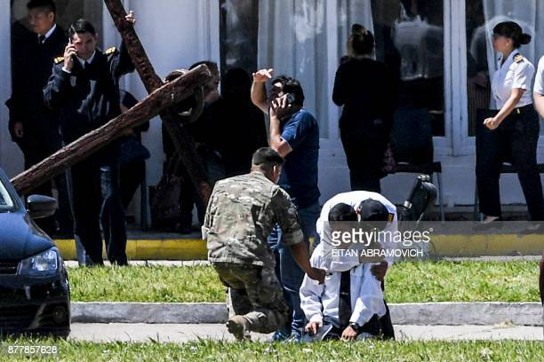 TOPSHOT Relatives and comrades of 44 crew members of Argentine missing submarine express their grief at Argentina's Navy base in Mar del Plata on the...
