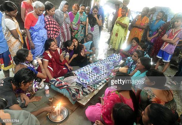 Relatives and family members mourn near the body of a victim of toxic homemade liquor consumption in Mumbai on June 19 2015 Fortyone people have died...