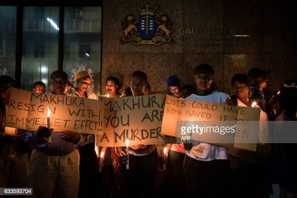 Relatives and family members of some of the 94 mentally ill patients who died last year hold a candle light vigil organized by South African main...