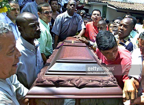 Relatives and fans of Colombian former international soccer player Albeiro 'Palomo' Usuriaga carry the coffin during his funeral 13 February 2004 in...