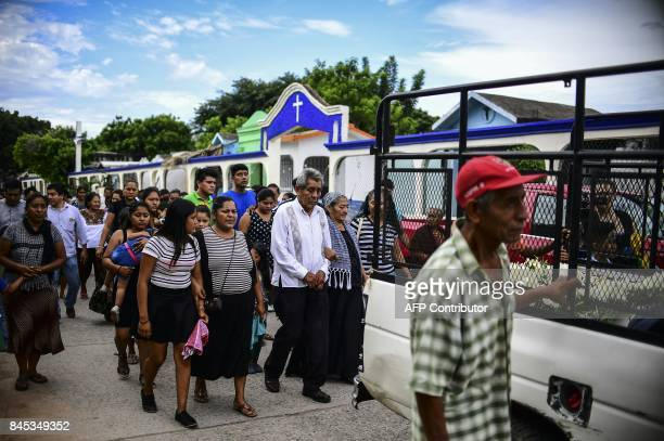 TOPSHOT Relatives and friends accompany to the cemetery the remains of a victim of Thursday night's 82magnitude quake in Juchitan Oaxaca Mexico on...
