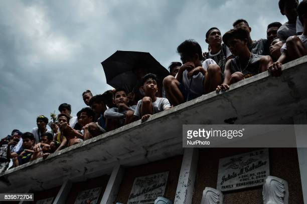 Relatives and friends attend the funeral rites of Kian Loyd Delos Santos in Caloocan Metro Manila Philippines August 26 2017 Amidst the drug...