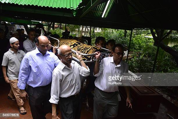 Relatives and friends carry the bodies of two Bangladeshi victims of the attack on Holey Artisan Bakery for burial in Dhaka BangladeshJuly 4 2016 The...
