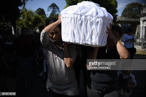 Relatives and friends carry the coffin of 17yearold Kimberly Mishel Palencia Ortiz who died in a fire at a staterun shelter during her funeral at the...