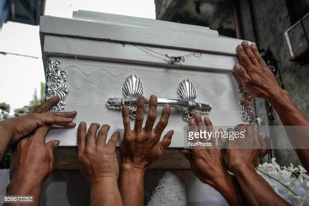 Relatives and friends carry the coffin of Kian Loyd Delos Santos during his funeral in Caloocan Metro Manila Philippines August 26 2017 Amidst the...