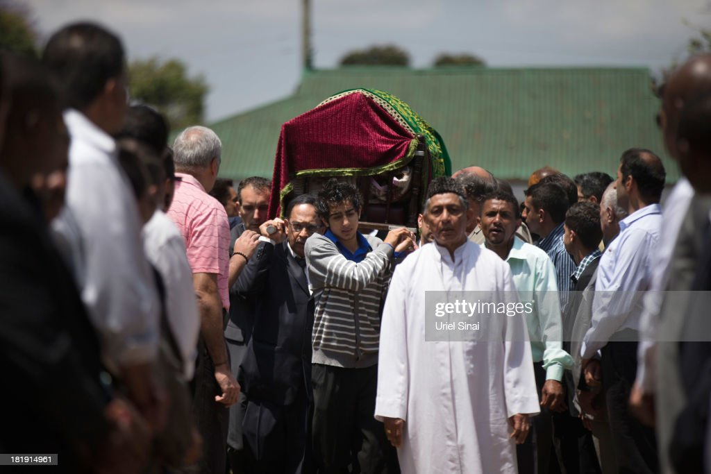 Relatives and friends carry the coffin of Ruhila Adatia Sood, A Radio Africa television and radio presenter, during her funeral ceremony on September 26, 2013 in Nairobi, Kenya. The country is observing three days of national mourning as security forces begin the task of clearing and securing the Westgate shopping mall following a four-day siege by militants.