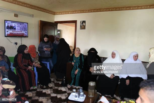 Relatives and friends gather in the family of home of Ahmad Dakamseh in Irbid 90 kilometres north of the capital Amman on March 12 upon Ahmad's...