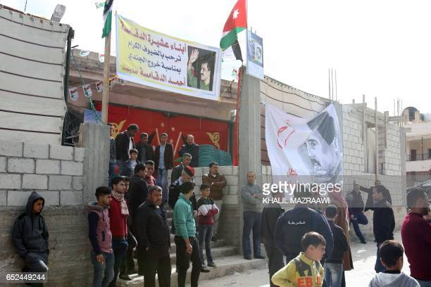 Relatives and friends gather outside a hall in Irbid 90 kilometres north of the capital Amman on March 12 upon Ahmad Dakamseh's release after serving...