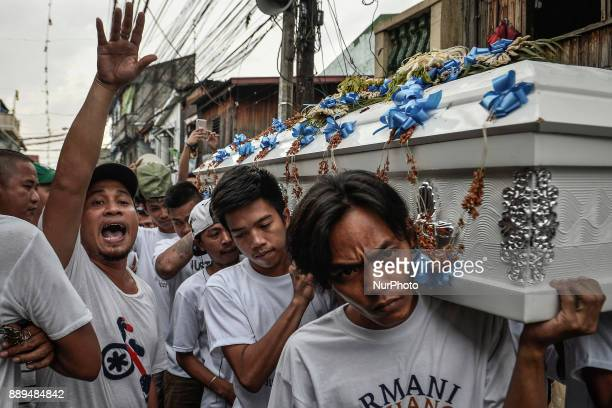 Relatives and friends of 13yearold Jayross Brondial who was killed by an unidentified gunman carry his coffin during his funeral in Pasay Metro...