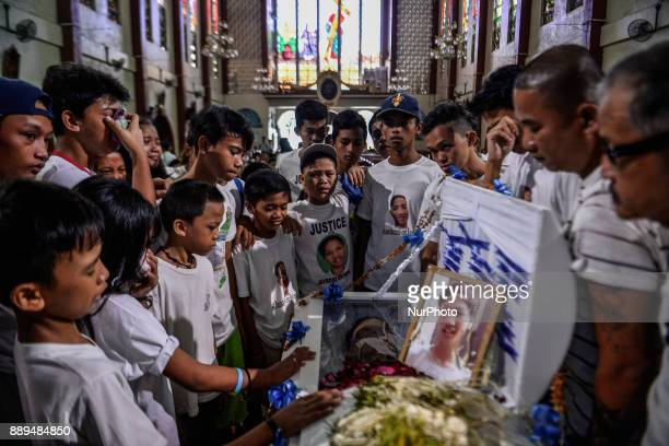 Relatives and friends of 13yearold Jayross Brondial who was killed by an unidentified gunman weep during his funeral in Pasay Metro Manila...