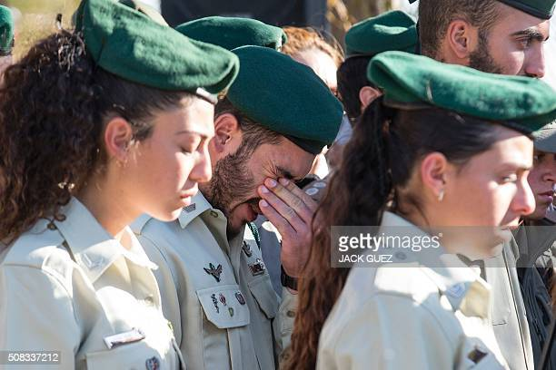 Relatives and friends of 19yearold Israeli border police officer Hadar Cohen mourn on February 4 2016 during her funeral in a cemetery in the town of...