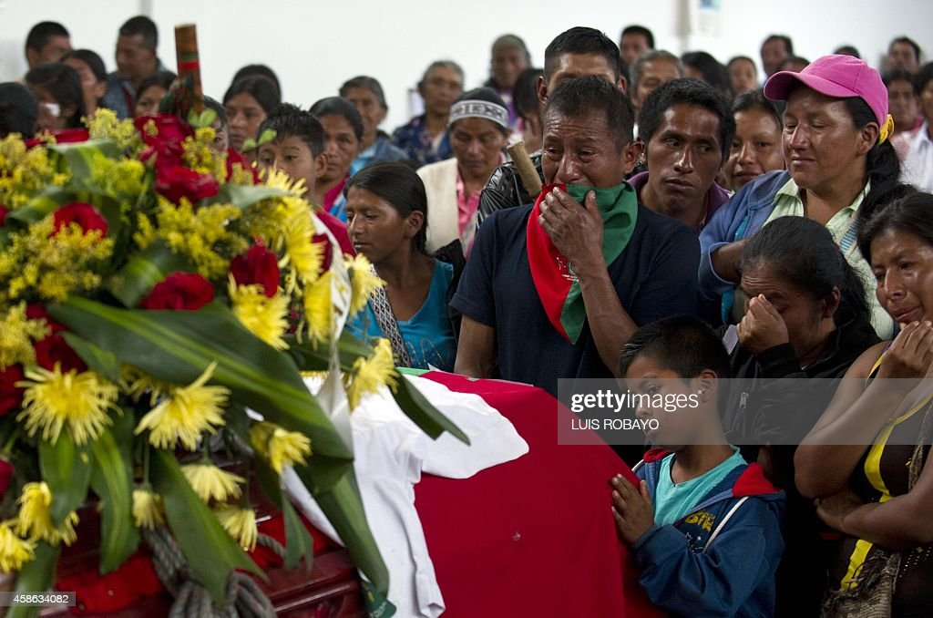 Relatives and friends of Daniel Coicue and Manuel Antonio Tumina members of the indigenous Nasa tribe recently killed by alleged rebels mourn during...