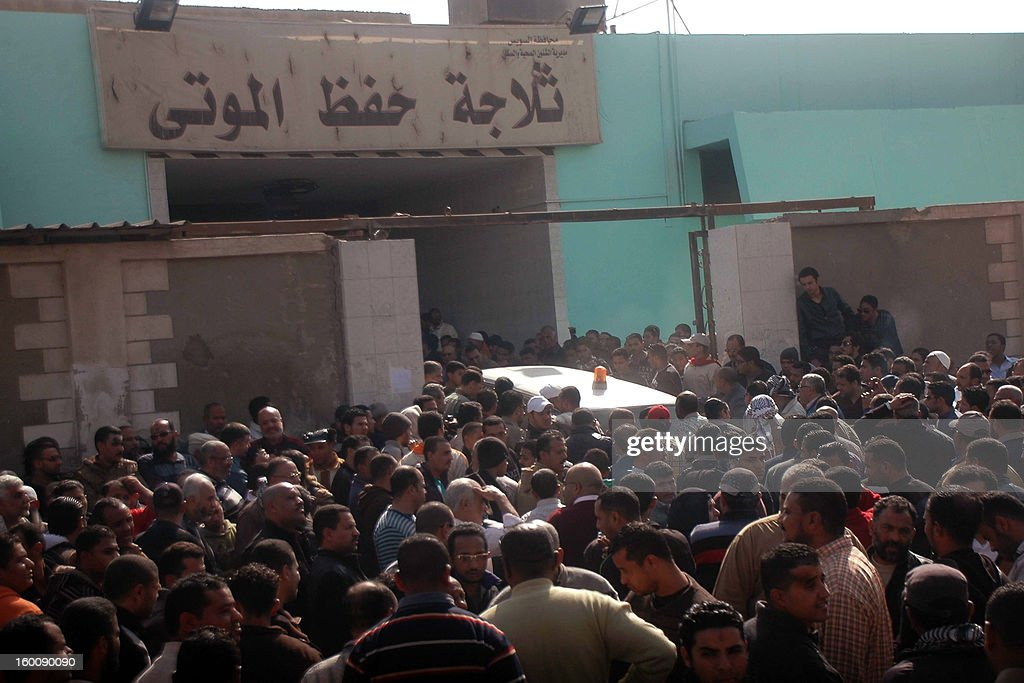Relatives and friends of Egyptian protesters who were killed in Suez during clashes with riot police yesterday, gather outside the morgue in Suez on January 26, 2013. Twenty-two people were killed in Port Said after 21 Egyptian football fans and club members were sentenced to death over a deadly post-match riot last year in the canal city.