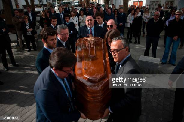 Relatives and friends of former Franco minister Jose Utrera Molina carry his coffin during funerals in Nerja on April 22 2017 One of the last...
