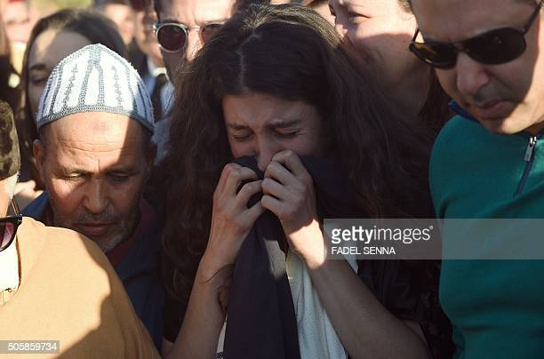 Relatives and friends of French Moroccan photographer Leila Alaoui mourn during her funeral at a cemetery in the Moroccan city of Marrakesh on...