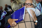 Relatives and friends of military personnel killed during the Iraq War hold a copy of the official report at a news conference after listening to Sir...