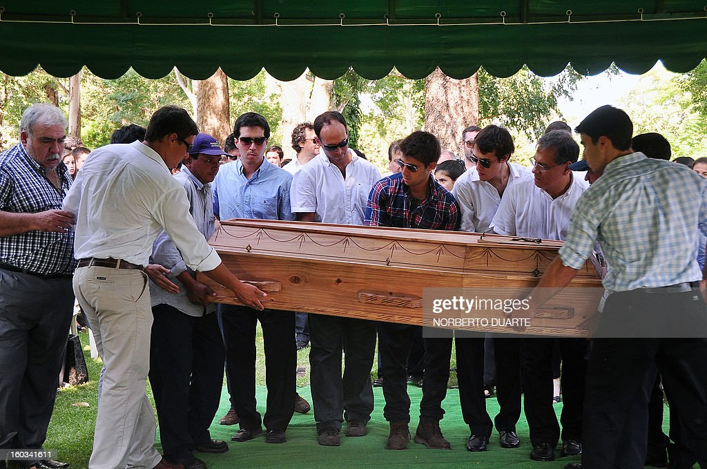 Relatives and friends of Paraguayan student Guido Britez, 21, who died on a fire accident in a nightclub in Brazil, carry his coffin during the funeral in Asuncion, on January 29, 2013. Britez died on January 27 during a blaze in a nightclub in Santa Maria, southern Brazil, which left 231 people dead and at least 100 others hospitalized, 80 of them in serious condition. AFP PHOTO/NORBERTO DUARTE