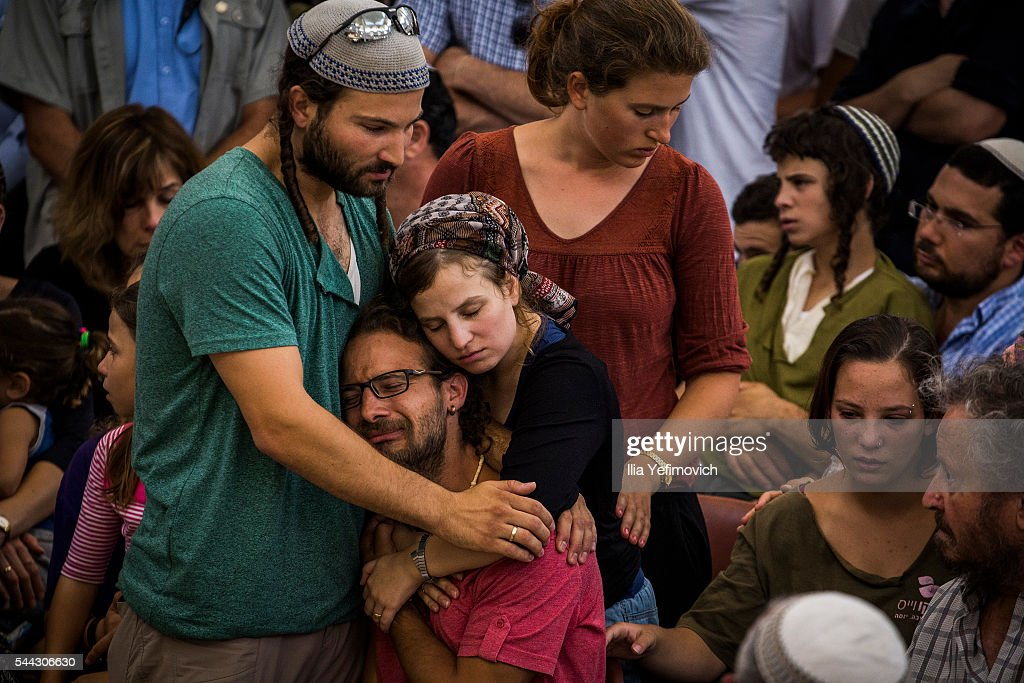 Relatives and friends of Rabbi Michael Mark mourn during his funeral on July 3, 2016 in Otniel, West Bank. Rabbi Michael Mark was shot and killed, and his wife and two children injured in a drive-by terrorist attack on his family car on route 60 in the West-Bank.