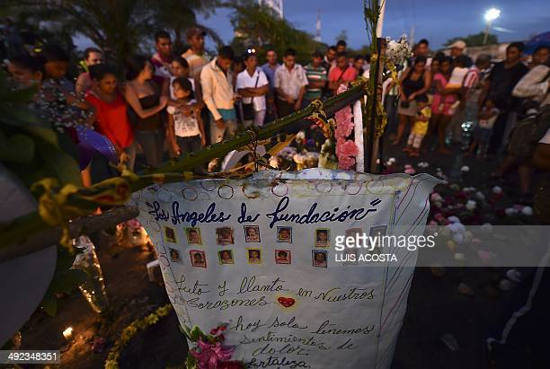 Relatives and friends of the 32 chlidren burnt to death inside a school bus in Fundacion department of Magdalena Colombia light candles on May 19...