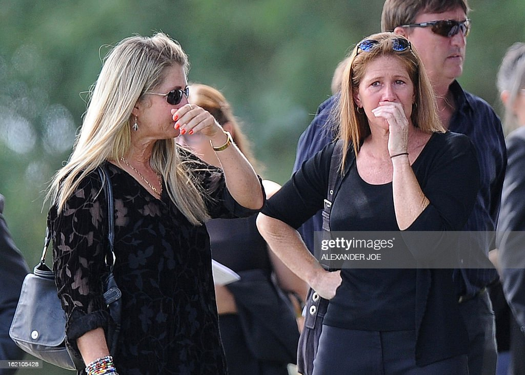 Relatives and friends of the late South African model Reeva Steenkamp mourn for the funeral ceremony at the crematorium building in Port Elizabeth on February 19, 2013 after Steenkamp, 29, was shot four times in the early hours of February 14, 2013 by a 9mm pistol owned by South African sporting hero Oscar Pistorius. South African prosecutors on Tuesday told a bail hearing that Oscar Pistorius was guilty of 'premeditated murder' in the Valentine's Day killing of his model girlfriend at his upscale home.