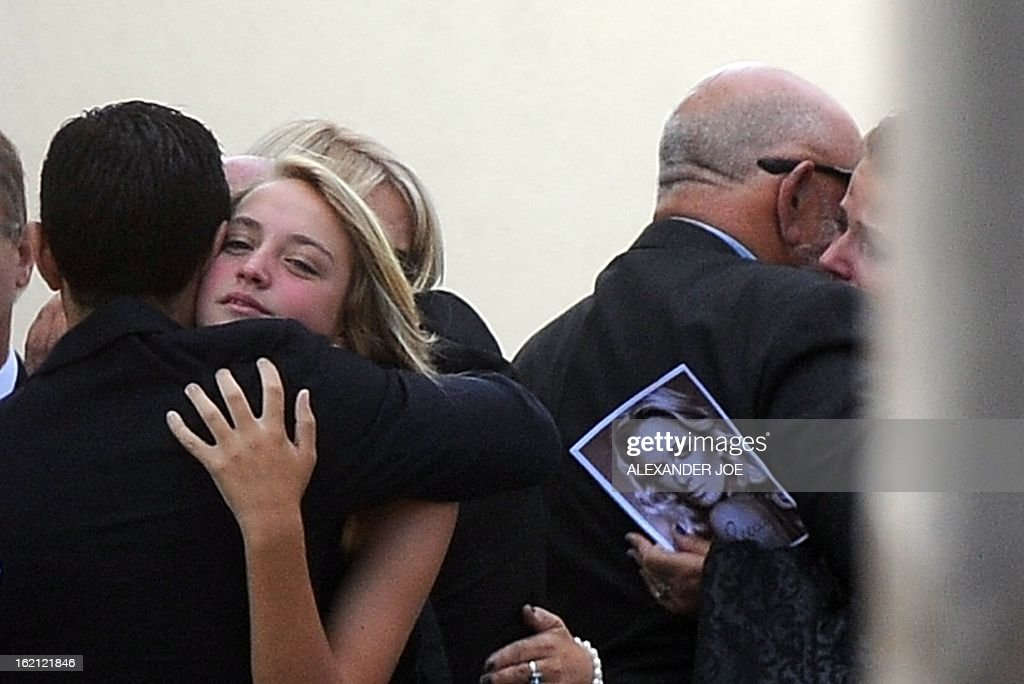 Relatives and friends of the late South African model Reeva Steenkamp mourn on February 19, 2013 during her funeral at a crematorium in Port Elizabeth. Steenkamp, 29, was shot four times in the early hours of February 14, 2013 by a 9mm pistol owned by South African sporting hero Oscar Pistorius. South African prosecutors said at a bail hearing on February 19 that Pistorius was guilty of 'premeditated murder' in the Valentine's Day killing of his model girlfriend at his upscale home.