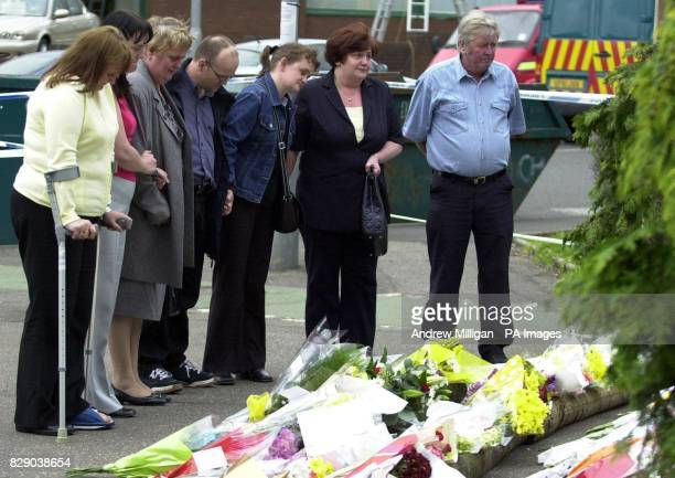 Relatives and friends of those killed and injured in the plastic's factor blast visits the scene in Glasgow to view flowers left by well wishers