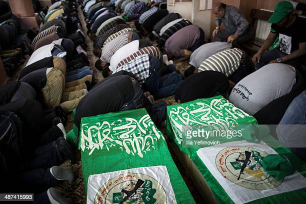 Relatives and Hamas supporters attend the funeral of two Hamas members Adel and Imad Awadallah on April 30 2014 in Ramallah West Bank in the West...