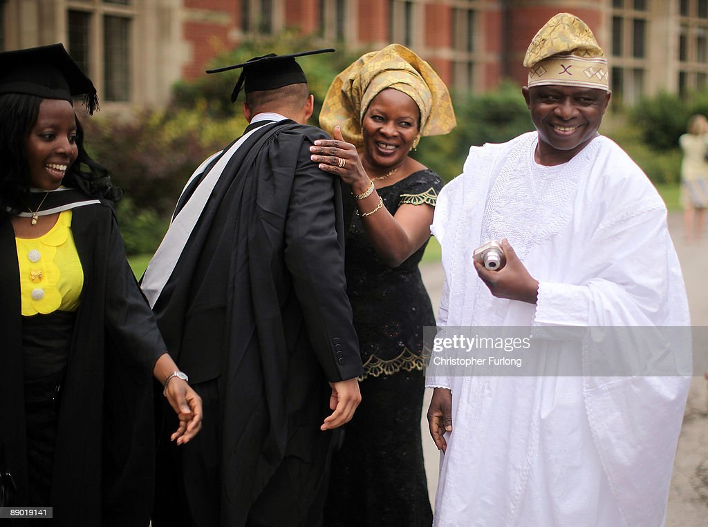 Relatives and students at the University of Birmingham take part in the degree congregations on July 14, 2009 in Birmingham, England. Over 5000 graduates will be donning their robes this week to collect their degrees from The University of Birmingham. A recent survey suggested that there are 48 graduates competing for every job.