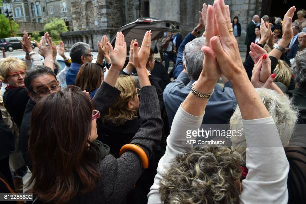 Relatives applaud at the end of the funeral of French judge JeanMichel Lambert at the SaintJulien Cathedral in Le Mans northwestern France on July 20...